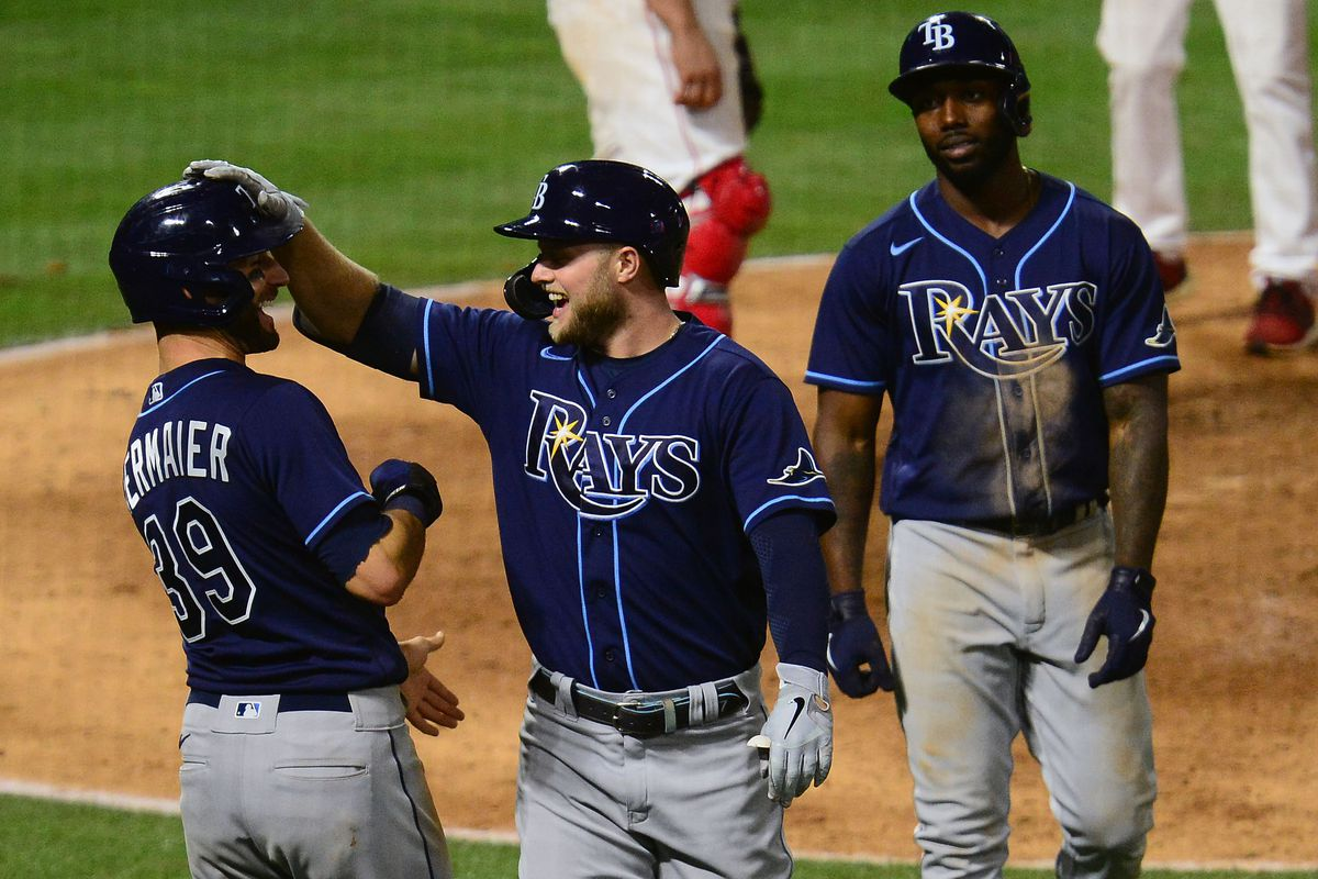 Tampa Bay Rays designated hitter Austin Meadows is greeted by left fielder Randy Arozarena and center fielder Kevin Kiermaier after hitting a three run home run against the Los Angeles Angels during the eighth inning at Angel Stadium.