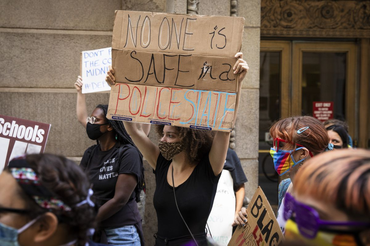 Protesters calling for the city to defund the Chicago Police Department rally outside City Hall in the Loop, Tuesday afternoon, Aug. 18, 2020. | Ashlee Rezin Garcia/Sun-Times