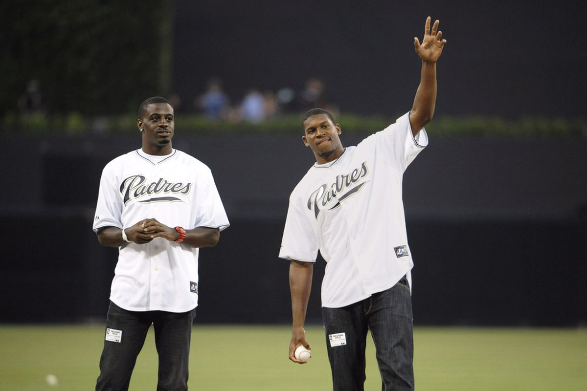 (L-R) San Diego Chargers draft picks Shareece Wright and Vincent Brown throw out the first pitch before a baseball game between the Colorado Rockies and the San Diego Padres at Petco Park.  (Photo by Denis Poroy/Getty Images)