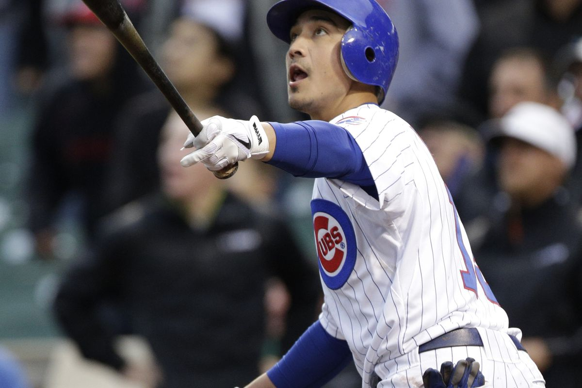 Darwin Barney of the Chicago Cubs hits a two-run home run against the St. Louis Cardinals at Wrigley Field in Chicago, Illinois. (Photo by John Gress/Getty Images)