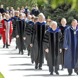 Elder M. Russell Ballard, front left, and President Cecil O. Samuelson, right, lead the procession to begin BYU's summer commencement exercises at the Marriott Center in Provo on Thursday.