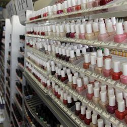 """Nail care products are displayed at a beauty supply shop in San Francisco,  Monday, April 9, 2012. California's chemical regulators randomly sampled dozens of professional grade nail polishes that claimed to be free of a """"toxic trio"""" of dangerous substances and found that many still contained the chemicals in high levels."""