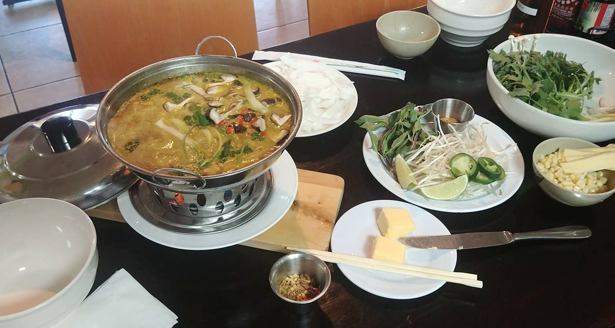 A silver bowl with pho