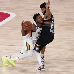Utah Jazz's Donovan Mitchell (45) works to advance the ball up court against Denver Nuggets' Jamal Murray (27) during the second half an NBA first round playoff basketball game, Tuesday, Sept. 1, 2020, in Lake Buena Vista, Fla.
