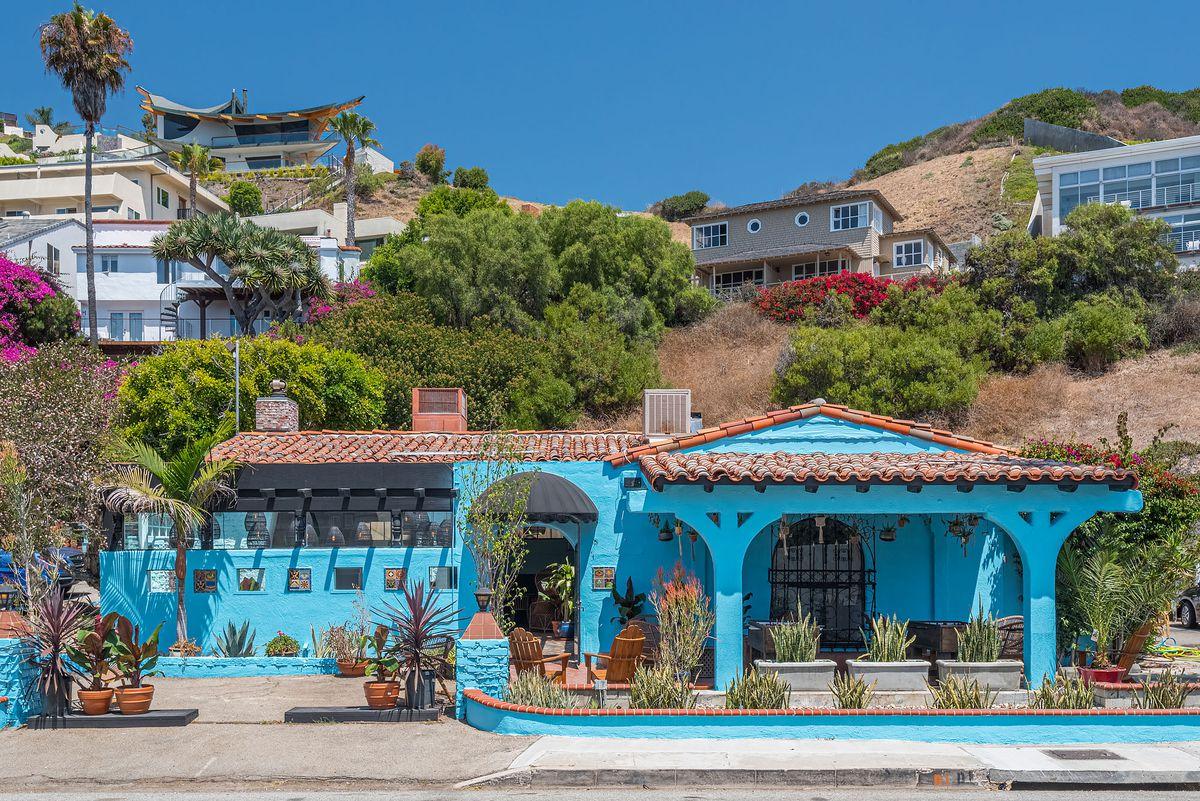 A bright blue roadside bar building in Malibu.