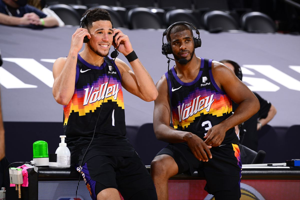 Devin Booker and Chris Paul of the Phoenix Suns get interviewed after the game against the Utah Jazz on April 7, 2021 at Phoenix Suns Arena in Phoenix, Arizona.