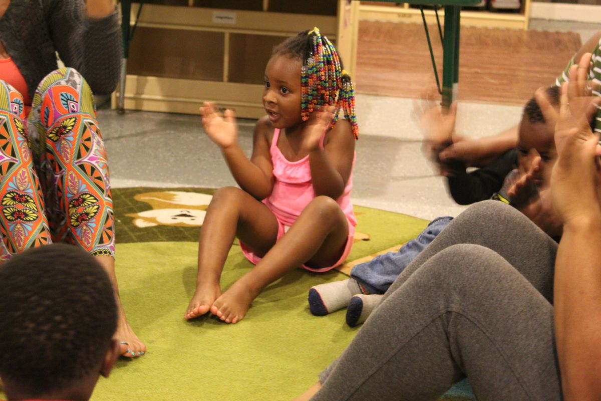 A student sings along with Kimberli Boyd, an artist with Living Arts Detroit Wolf Trap.