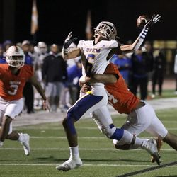 Timpview's Paeae Alatini (34) stops Orem's Roger Saleapaga (6) from catching a pass at Timpview High in Provo on Thursday, Sept. 30, 2021.