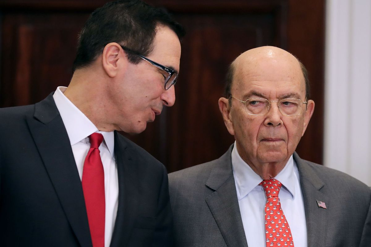 Treasury Secretary Steve Mnuchin talks to Commerce Secretary Wilbur Ross at an event in the White House in March 2018.