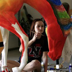 McCall Takos paints a fiberglass horse for Ogden Pioneer Days. The horses will be among 55 displayed around downtown Ogden from July through October.