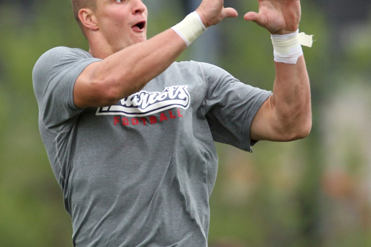 July 27, 2012; Foxborough, MA, USA; New England Patriots tight end Rob Gronkowski catches a pass during training camp at the team practice facility. Mandatory Credit: Stew Milne-US PRESSWIRE