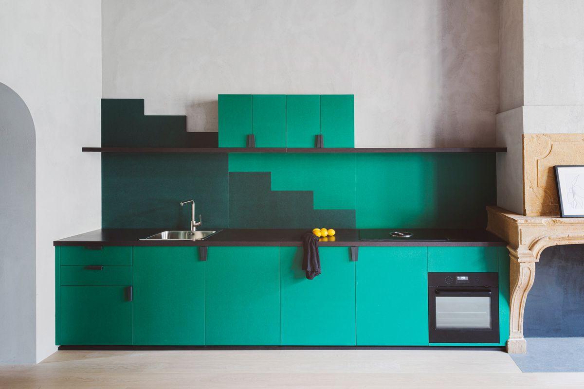 Green kitchen cabinets.