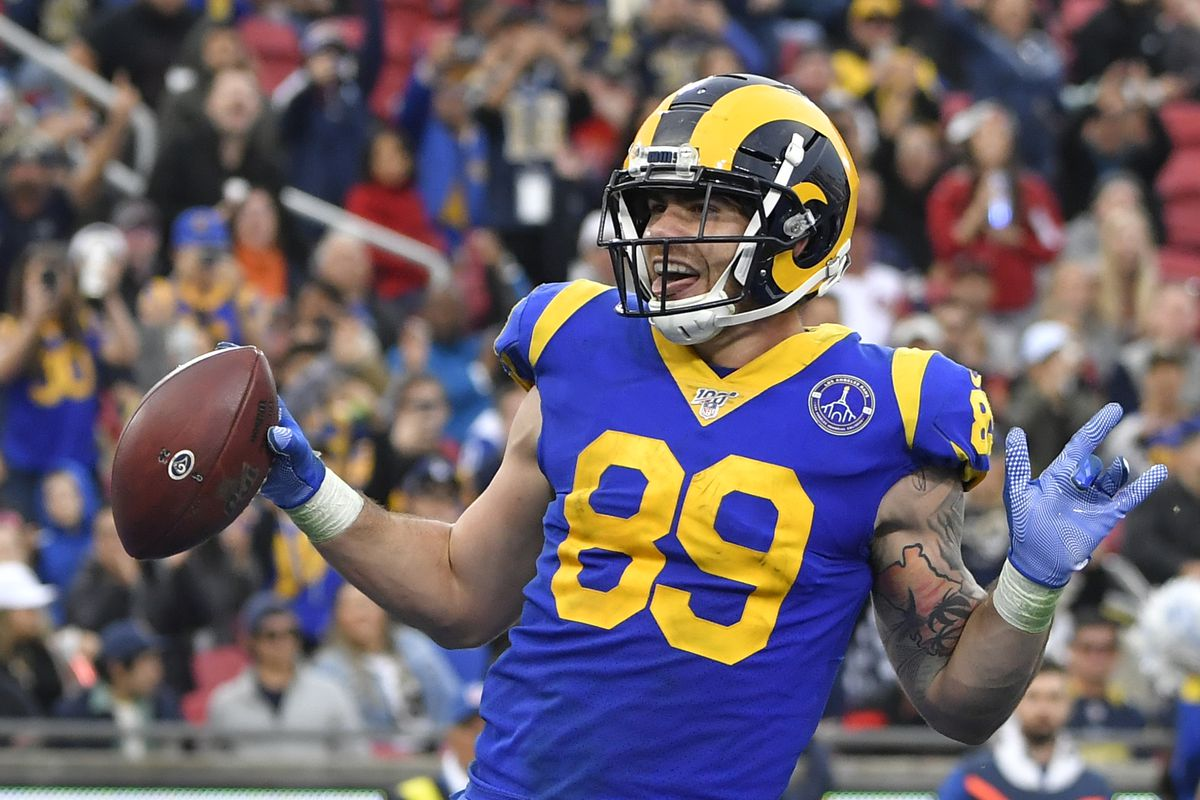 Tyler Higbee #89 of the Los Angeles Rams gets past Zeke Turner #47 of the Arizona Cardinals to score a touchdown at Los Angeles Memorial Coliseum on December 29, 2019 in Los Angeles, California.
