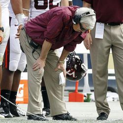 Virginia Tech head coach Frank Beamer puts his hands on his knees as he stands along the sideline after his team failed to convert a fourth down in the fourth quarter of their NCAA college football game against Pittsburgh, Saturday, Sept. 15, 2012, in Pittsburgh. Pittsburgh won 35-17.