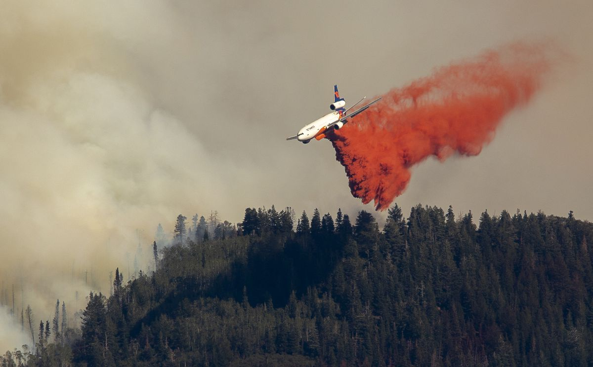 An air tanker drops retardant on the Parleys Canyon west of Park City on Saturday, Aug. 14, 2021.