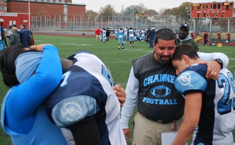 Breland Archbold, left, Beach Channel coach Victor Nazario and Justin Zemser, right, in 2012 after the final game of the season.