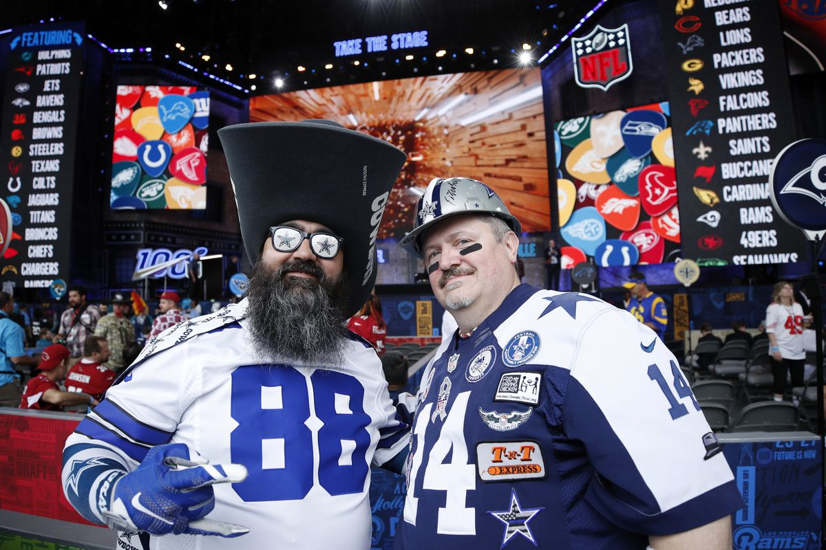 A pair of Dallas Cowboys fans are seen prior to the first round of the NFL Draft on April 25, 2019 in Nashville, Tennessee.