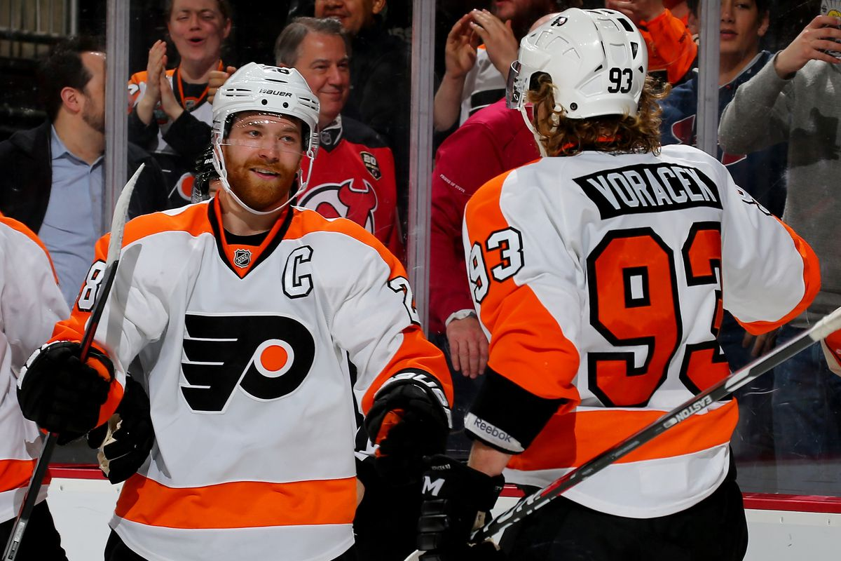 NEWARK, NJ - FEBRUARY 16: Claude Giroux #28 of the Philadelphia Flyers congratulates teammate Jakub Voracek #93 after he scored a goal in the third period against the New Jersey Devils on February 16, 2016 at Prudential Center in Newark, New Jersey.The Ph