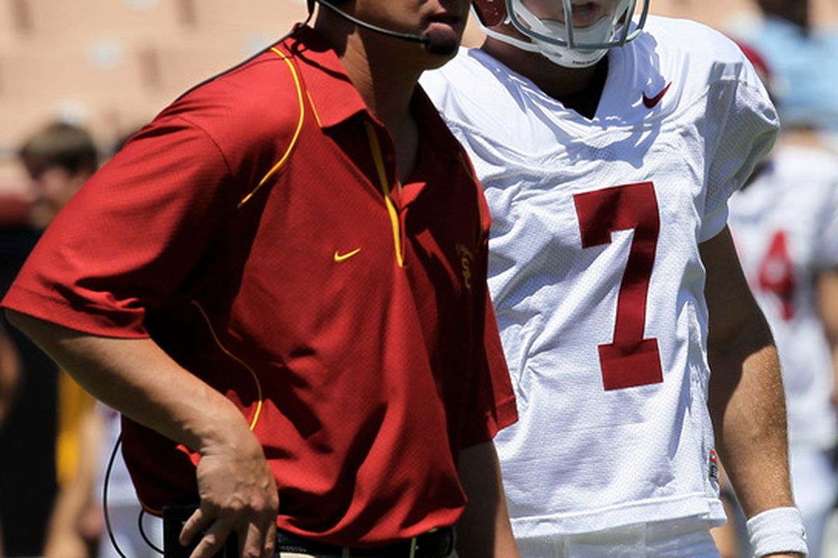 LOS ANGELES, CA - MAY 01:  Head coach Lane Kiffin talks with quarterback Matt Barkley #7 during the  USC Trojans spring game on  May 1, 2010 at the Los Angeles Memorial Coliseum in Los Angeles, California.  (Photo by Stephen Dunn/Getty Images)