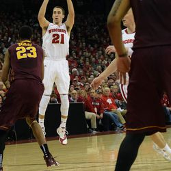 Josh Gasser puts up a jump shot over Minnesota's Charles Buggs