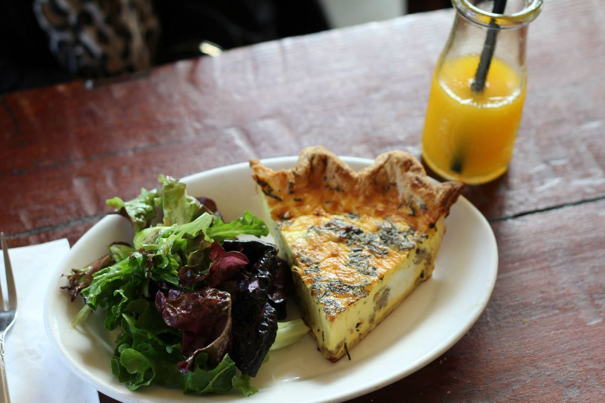 Quiche with greens and an orange juice at Volunteer Park Cafe.