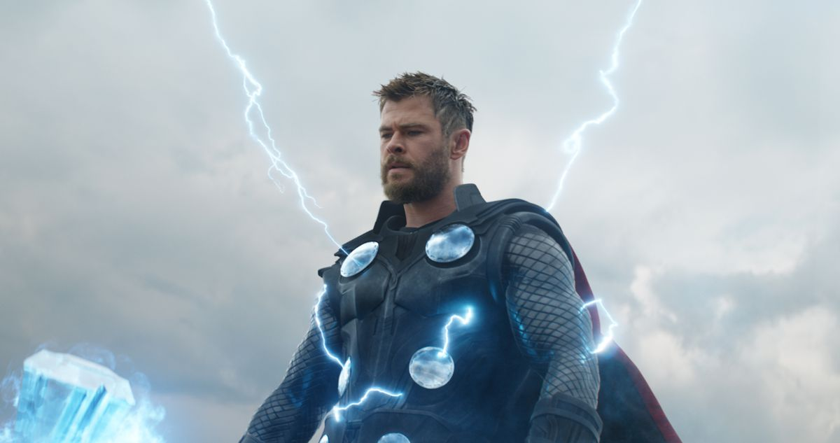Avengers: Endgame - Thor holding his Stormbreaker Axe as lightning emanates from him