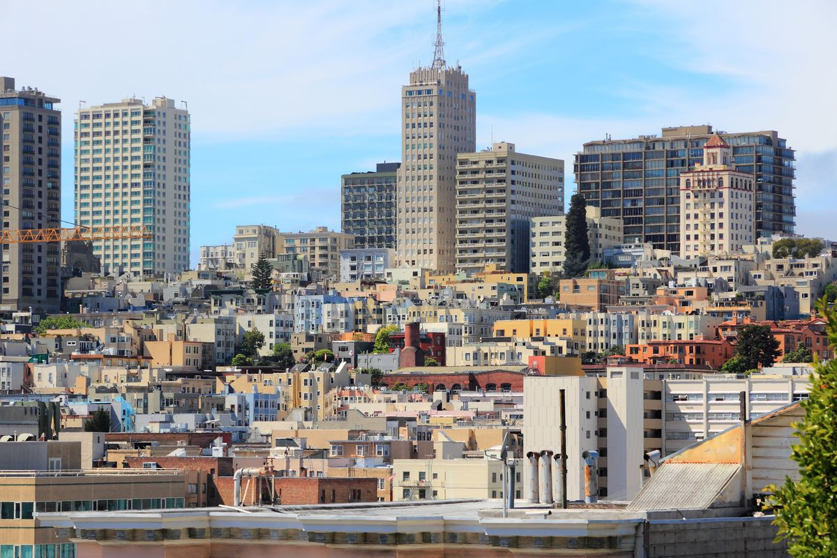 Mid- and high-rise buildings with a blue sky as a backdrop in San Francisco.