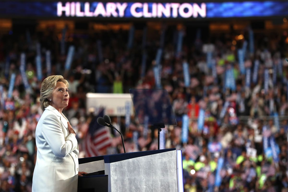 Democratic presidential candidate Hillary Clinton acknowledges the crowd as she arrives on stage at the DNC
