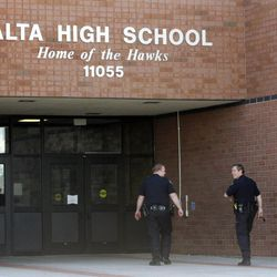 Sandy police officers walk outside Alta High School in Sandy on Tuesday, March 29, 2011. The school's principal and assistant principal had been placed on administrative leave.
