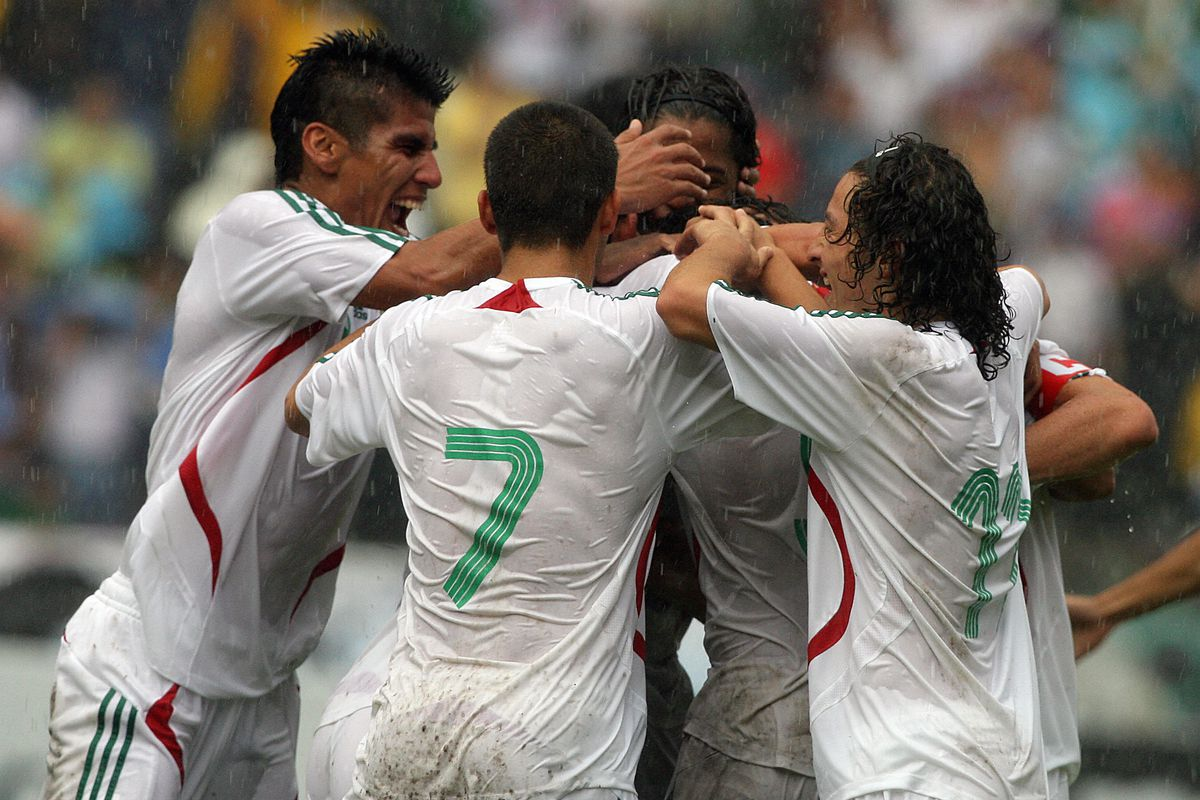 Mexican players celebrate a goal against