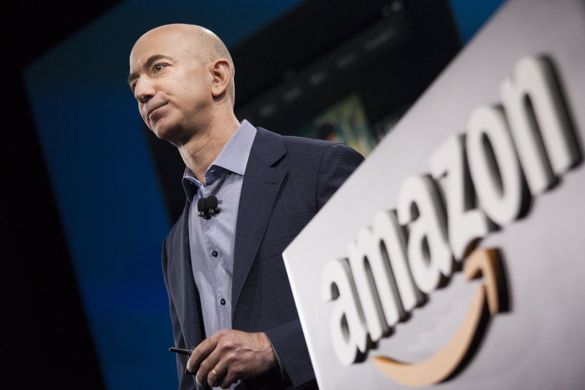 Amazon.com founder and CEO Jeff Bezos presents the company's first smartphone, the Fire Phone, on June 18, 2014 in Seattle, Washington.