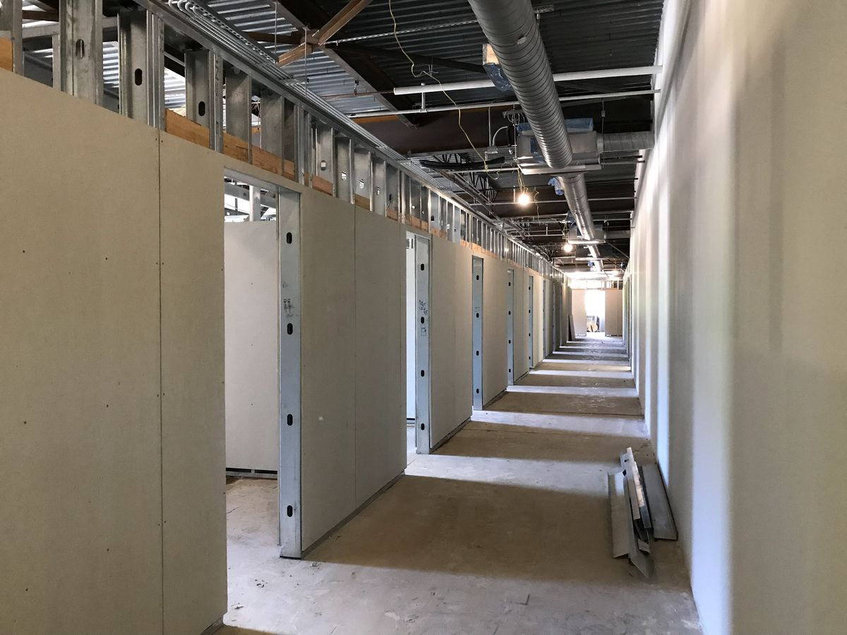 A picture of new offices being built inside an old warehouse.