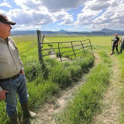 Panguitch resident Maloy Dodds watches his son Wally and grandson Makoy Dodds walk toward him Monday, June 8, 2015, in Panguitch.