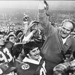 BYU head football coach LaVell Edwards is carried after winning the Holiday Bowl on Dec. 19, 1981.