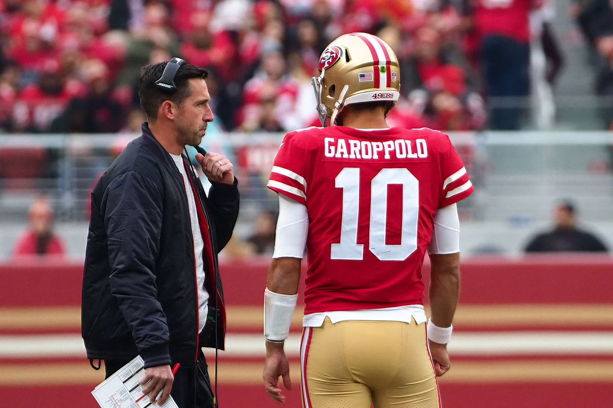 San Francisco 49ers head coach Kyle Shanahan speaks with quarterback Jimmy Garoppolo between plays against the Jacksonville Jaguars during the second quarter at Levi's Stadium.