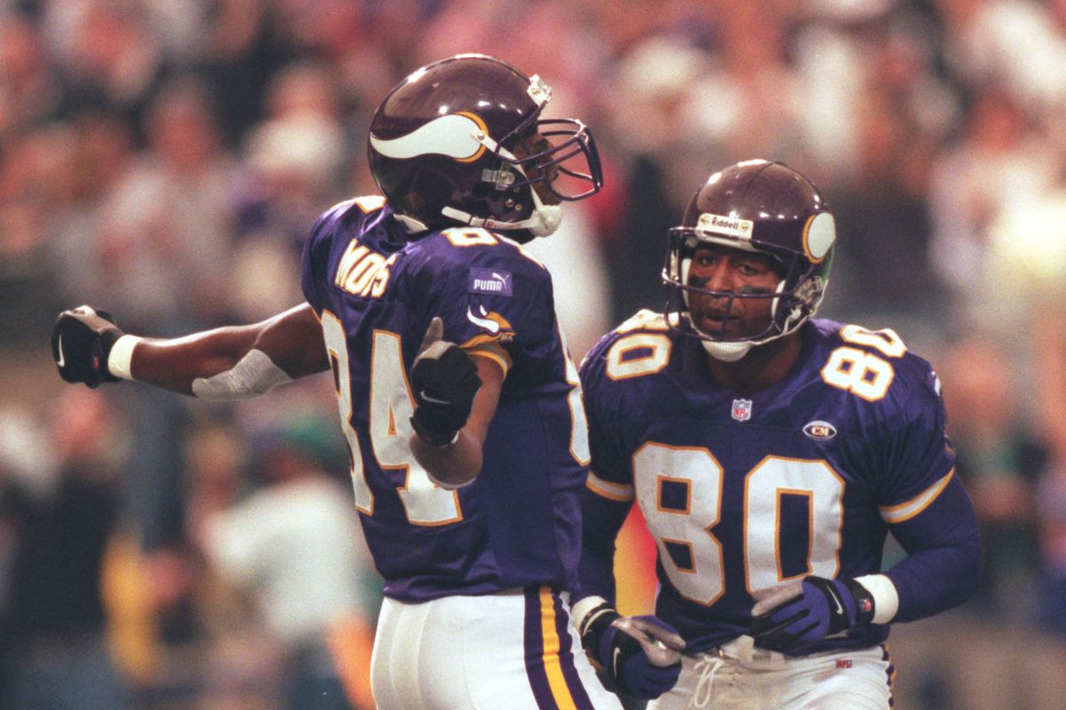 Minneapolis, MN 10/3/99 Vikings vs. Tampa Bay Buccaneers — Randy Moss, left, celebrates his second touchdown of the day with Cris Carter, right, putting the Vikings ahead of Tampa Bay 14-0 in the first quarter.