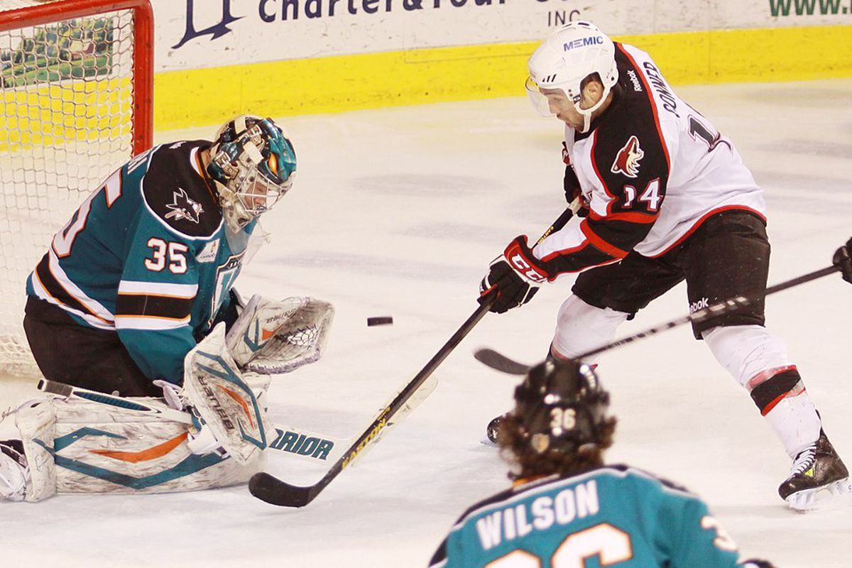 Worcester Sharks goaltender Harri Sateri makes one of his 28 saves Friday night against the Portland Pirates.