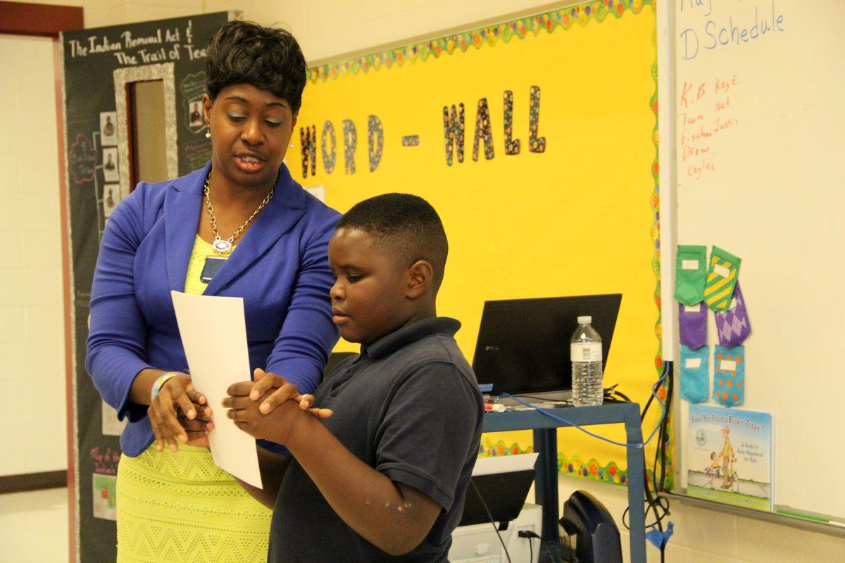 Fourth grade ELA teacher and PBS digital innovator Sharon Clark helps a student during class at East Side Intermediate School in Brownsville,Tenn.