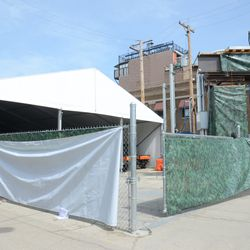 Tarps going up in front of the VIP/Players parking lot -
