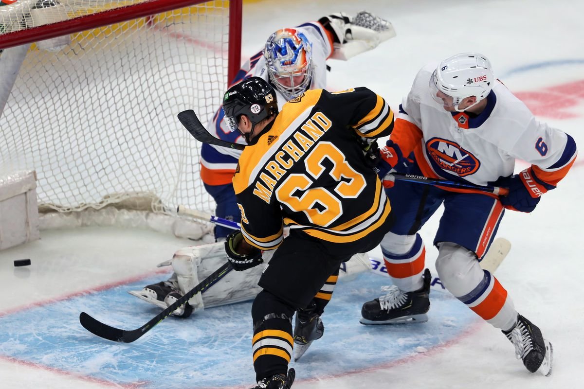 The Bruins Brad Marchand beats Islanders goalie Semyon Varlamov for a second period goal during a regular season NHL game on May 10, 2021 at TD Garden in Boston, MA.