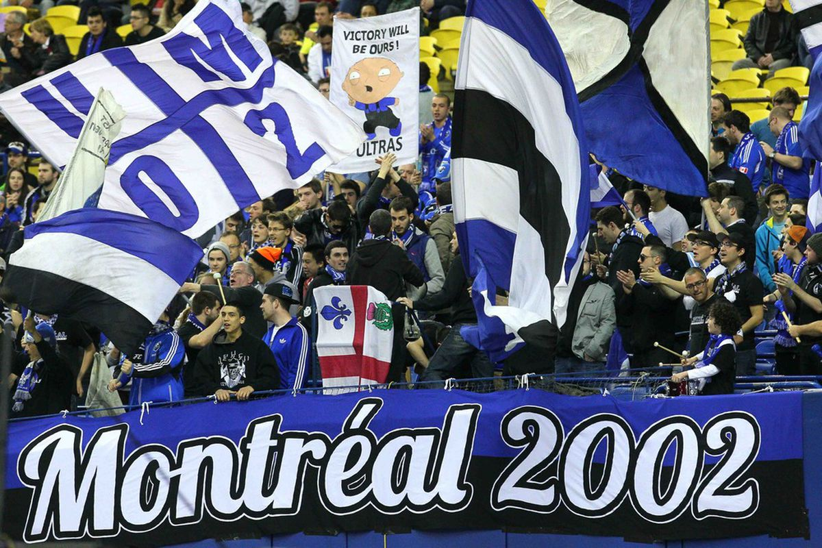 April 07, 2012; Montreal, QC, CAN; Montreal Impact fans hold flags during the first half against Toronto FC at the Olympic Stadium. Mandatory Credit: Jean-Yves Ahern-US PRESSWIRE.