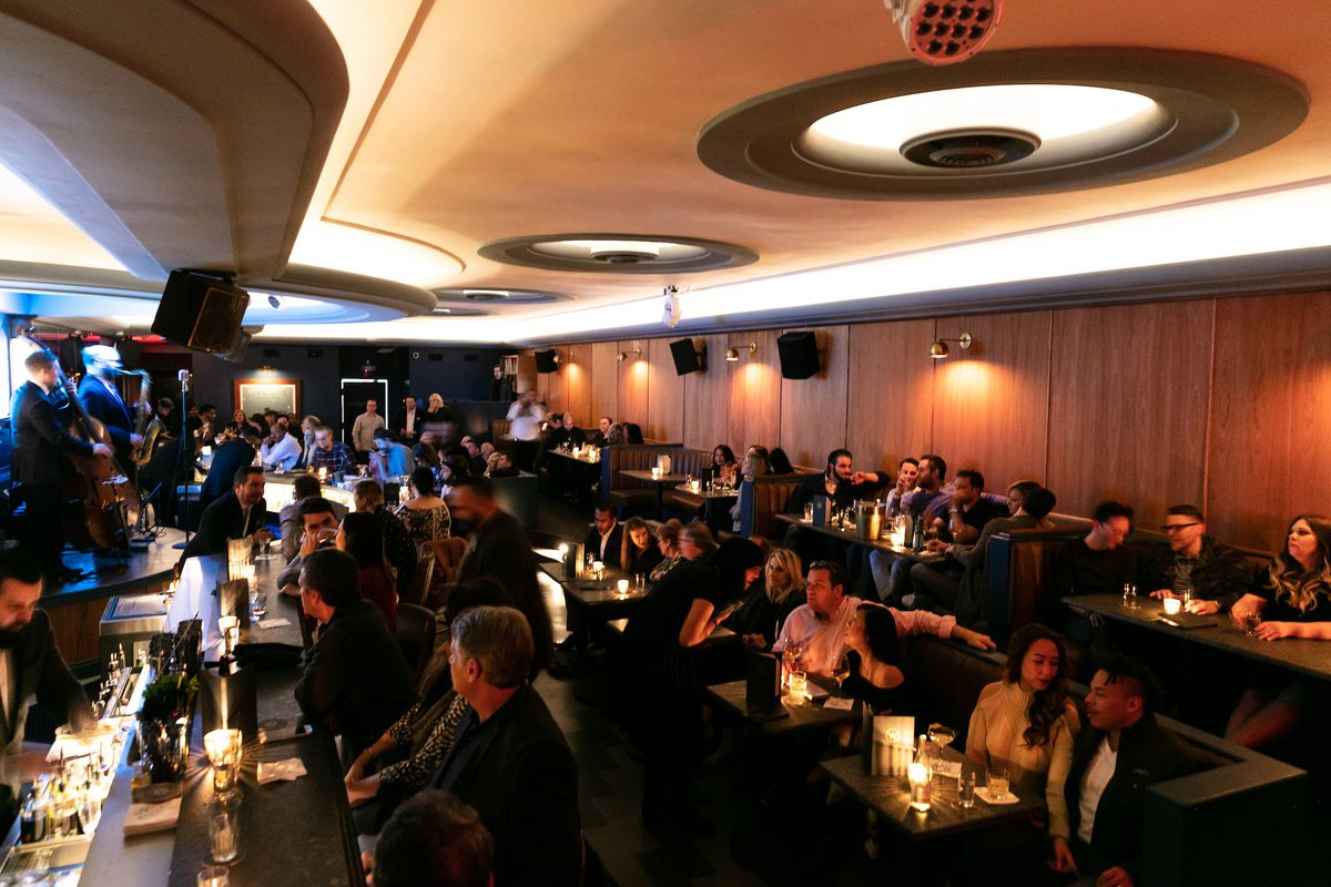 The Willis Show bar features an art moderne interior with a stage behind the bar. Full booths and tables all face the bar.