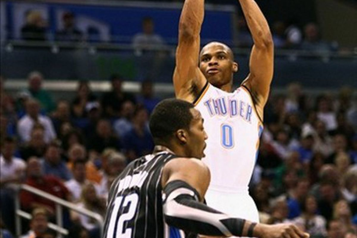Mar 1, 2012; Orlando, FL, USA; Oklahoma City Thunder point guard Russell Westbrook (0) attempts a shot during the first quarter against the Orlando Magic at Amway Center. Mandatory Credit: Douglas Jones-US PRESSWIRE