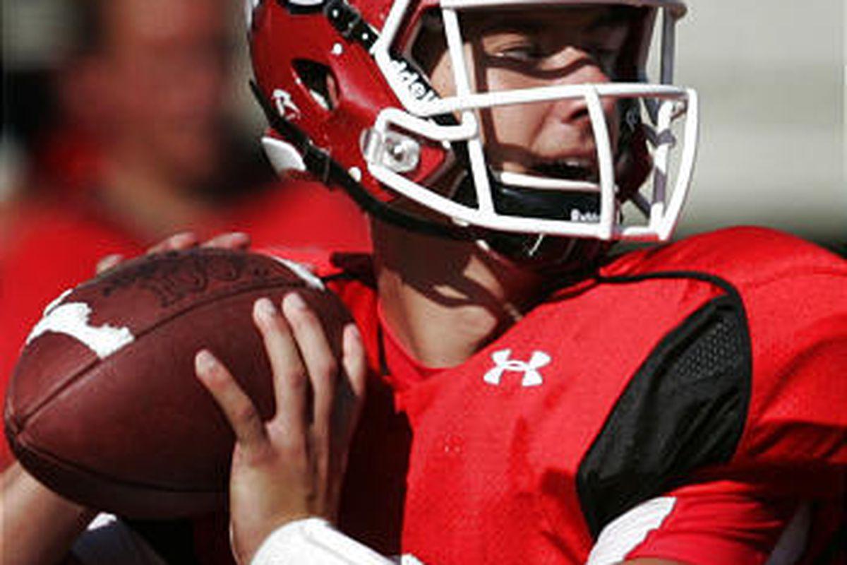 Jordan Wynn, the freshman quarterback for the Utah Utes, looks for his receiver during football practice at Rice-Eccles Stadium on the University of Utah campus Friday.