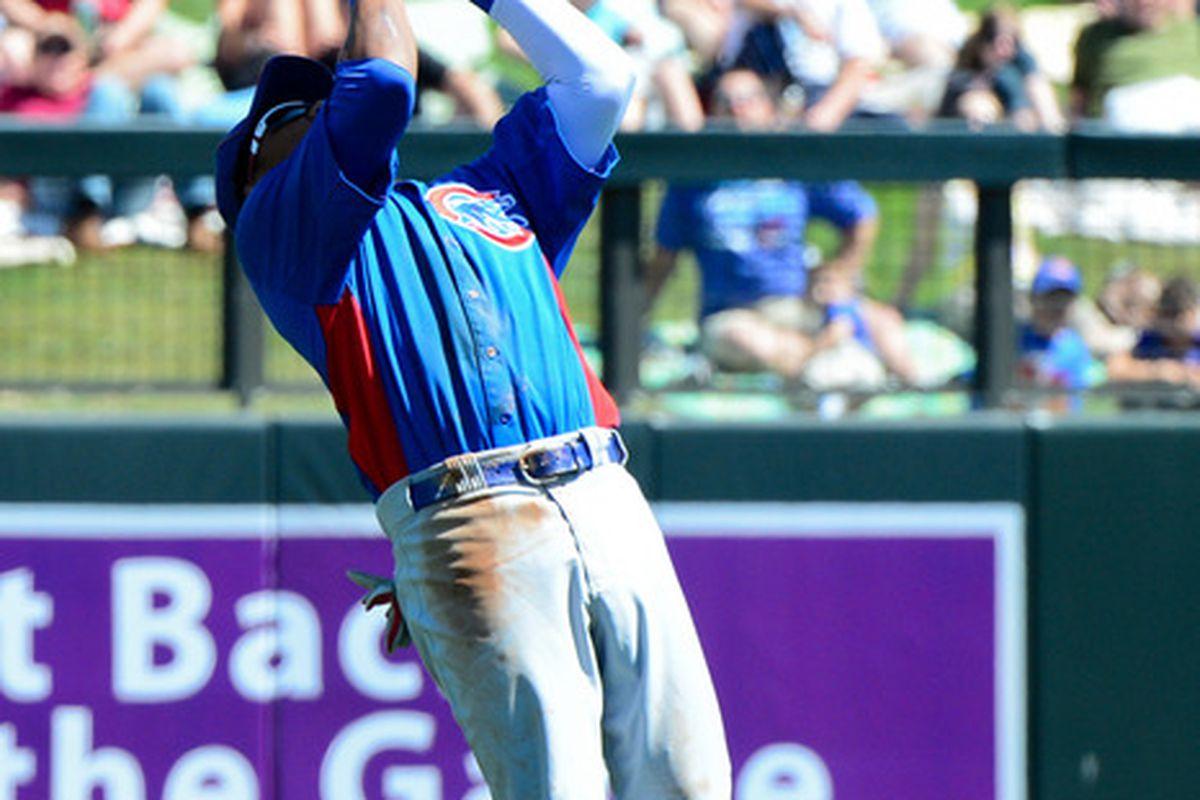 Scottsdale, AZ, USA; Chicago Cubs shortstop Starlin Castro catches a fly ball hit by Arizona Diamondbacks right fielder Justin Upton during the first inning at Salt River Fields. Credit: Matt Kartozian-US PRESSWIRE