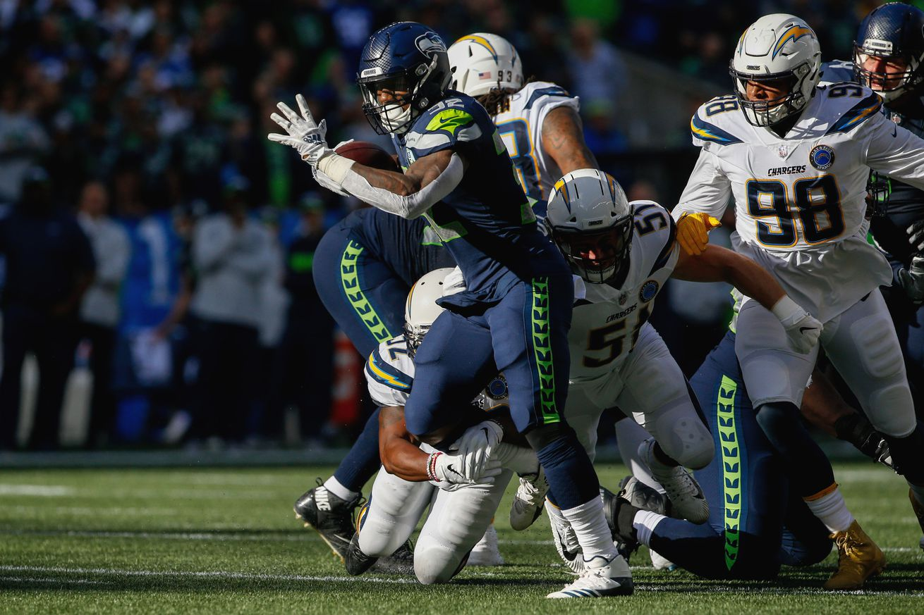 Chris Carson, DJ Fluker full participants on Tuesday