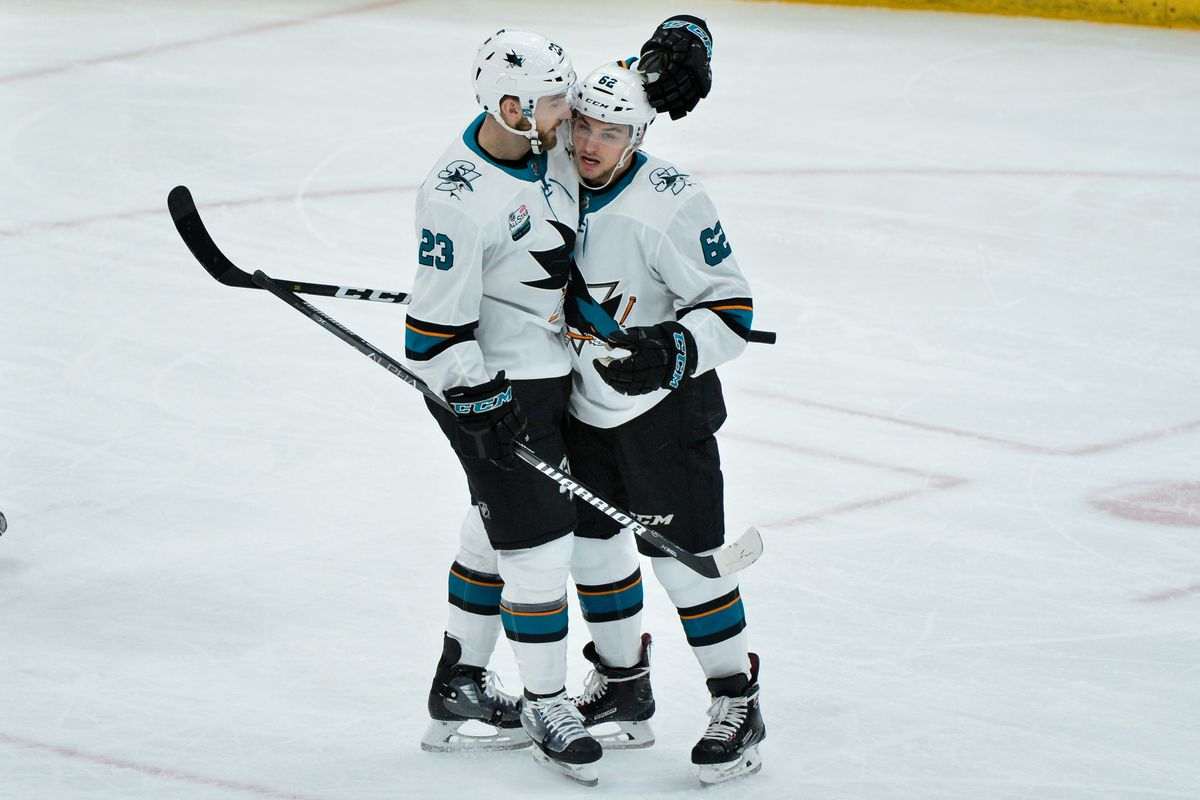 San Jose Sharks right wing Kevin Labanc (62) celebrates with right wing Barclay Goodrow (23) after scoring a goal in the first period against the Arizona Coyotes at Gila River Arena.