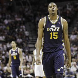 Utah Jazz's Derrick Favors (15) and teammates walk upcourt following a called foul during the fourth quarter of Game 1 of a first-round NBA basketball playoff series game against the San Antonio Spurs, Sunday, April 29, 2012, in San Antonio. San Antonio won 106-91. (AP Photo/Eric Gay)