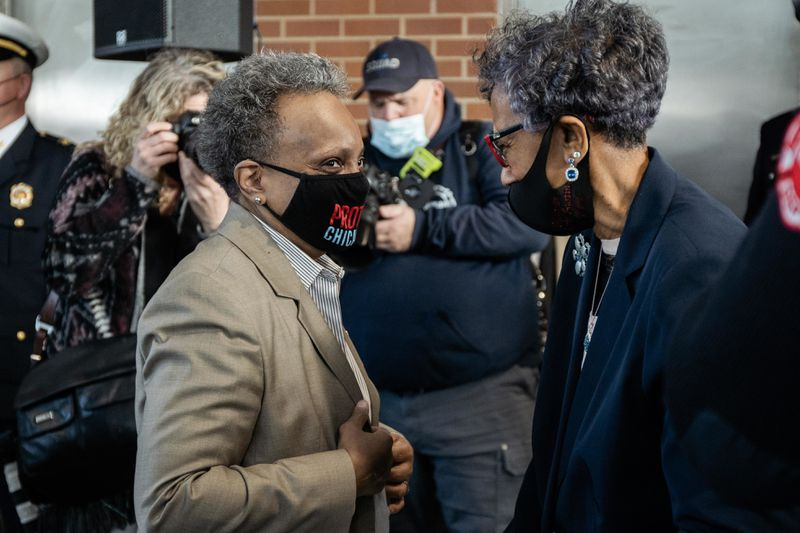 Mayor Lori Lightfoot greets Ald. Carrie Austin (34th) during a press conference about the opening of Engine Company 115's new firehouse at 1024 W. 119th St. in the West Pullman neighborhood, Wednesday morning, March 31, 2021.