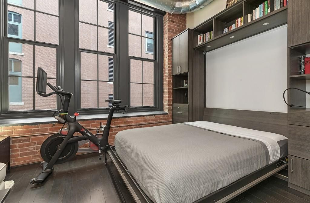A bed as opened from those shelves, and it's next to the exercise bike.